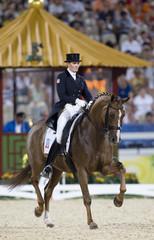 Holzer of Canda riding Pop Art performs during the equestrian dressage individual grand prix freestyle competition at the Beijing 2008 Olympic Games in Hong Kong