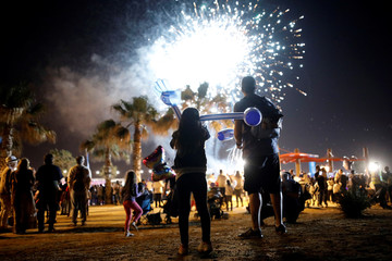 Israelis watch a fireworks show during celebrations marking Israel's 69th Independence Day in the southern city of Ashkelon