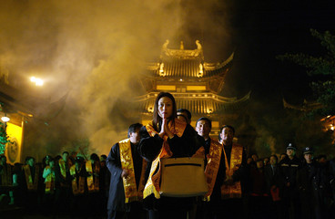 People wait in line to get into Longhua Temple to show their respect to Buddha in Shanghai
