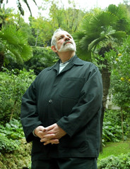 U.S. film director Brian De Palma stands in front of palm trees as he poses for pictures at a hotel ..