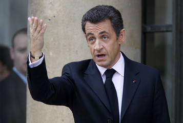 France's President Nicolas Sarkozy waves his guests in the courtyard of the Elysee Palace after a New Year greetings ceremony in Paris
