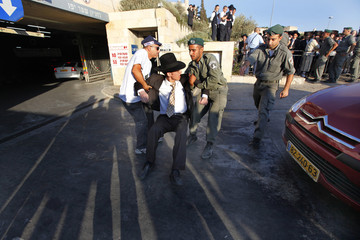 An ultra-Orthodox Jew blocks the entrance to a parking lot during a protest in Jerusalem