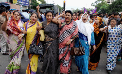 Women supporters of Bangladesh Awami League march during protest against bomb blasts in Dhaka.