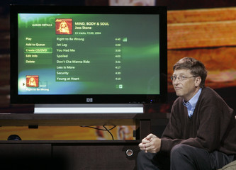 Bill Gates listens to music during digital Entertainment Anywhere launch event.