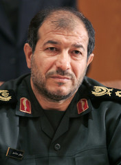 Iran's Defence Minister Mostafa Mohammad Najjar attends a meeting with his [Syrian counterpart Lieut..