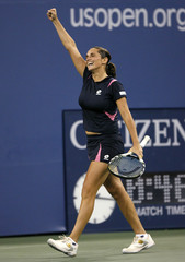 Roberta Vinci of Italy celebrates winning her only game against Maria Sharapova of Russia during their match at the U.S. Open tennis tournament in Flushing Meadows, New York