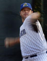 Trenton Thunder pitcher Roger Clemens throws a warm-up pitch before the start of the Thunder versus the Portland Sea Dogs Eastern minor league baseball game in Trenton New Jersey