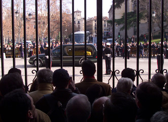 SPANISH KING'S MOTHER HEARSE DRIVES PAST CITIZENS OUTSIDE MADRID'S ROYAL PALACE.