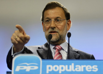 Spain's main opposition leader Rajoy gestures during a news conference at Popular Party's headquarters in Madrid