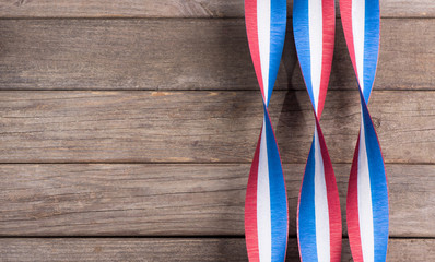 Red White and Blue Ribbons on a Rustic Wooden Background