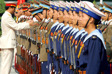 A Vietnamese military officer adjusts uniform for the honour guard at the Presidential Palace in on ...