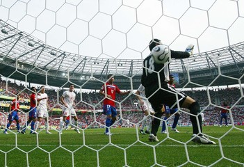 Costa Rica's Jose Porras lets in goal by Poland's Bartosz Bosacki during Group A World Cup 2006 soccer match in Hanover