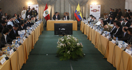 Peru's President Garcia and Ecuadorean President Correa give a speech during a meeting in Piura