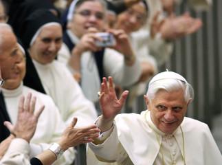 Pope Benedict XVI greets crowd in the Vatican