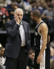 Spurs head coach Popovich reacts as he talks to Spurs Parker during the first half of Game 4 of their NBA Western Conference quarterfinal basketball game in Dallas
