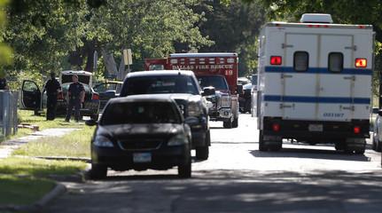 Dallas Police investigators process the scene of a shooting incident in Dallas