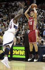 West of the Cleveland Cavaliers shoots over Williams of the Atlanta Hawks during Game 4 of their NBA Eastern Conference semi-final playoff basketball game in Atlanta