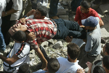 PALESTINIANS EVACUATE A WOUNDED PALESTINIAN AFTER ISRAELI MISSILESTRIKE IN GAZA.