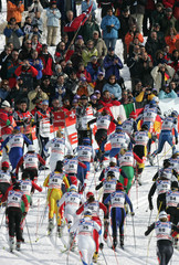 Competitors go up hill during the women's 15km pursuit cross country race at the Nordic World ...