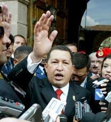 Venezuelan President Hugo Chavez waves at hotel in Cuzco.