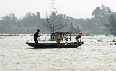 Residents are seen in a boat in a flooded village in Vietnam's central Thua Thien Hue province