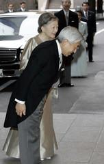 Japanese Emperor Akihito and Empress Michiko arrive at the hotel for Princess Sayako's wedding in Tokyo