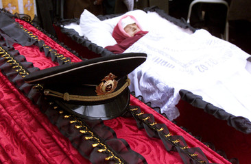 THE HAT OF RUSSIAN KURSK SUBMARINE KURSK SAILOR KUZNETSOV LIES ON HIS COFFIN ALONGSIDE THE BODY OF ...