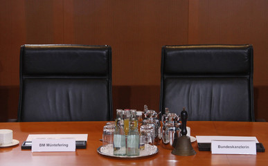 The empty chairs of German Chancellor Merkel and Vice Chancellor Muentefering are seen before the start of the the weekly cabinet meeting in Berlin