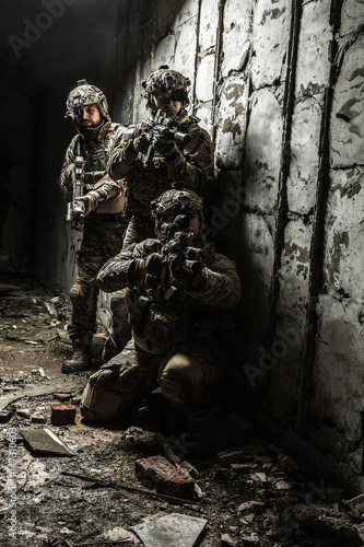 Squad of Army Rangers with rifle and machine gun moving