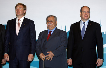 Dutch Prince Willem-Alexander, Iraqi President Jalal Talabani and Prince Albert of Monaco pose for a family photo during the 5th World Water Forum in Istanbul