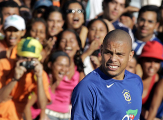 Brazilian soccer star Ronaldo reacts during a training session in Maceio.