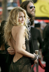 Actress Kate Hudson and her husband, Black Crowes lead singer Chris Robinson, arrive at the worldwid..