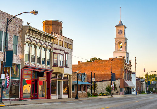 Main street of rural small town in midwest USA with storefronts and clock tower