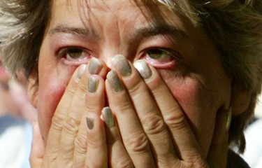 A WOMAN WIPES TEARS FROM HER EYES AS MAXINE CARR LEAVES PETERBOROUGHMAGISTRATES COURT.