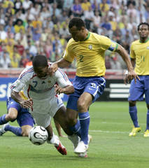 Brazil's Cafu fights for the ball with France's Florent Malouda in Frankfurt