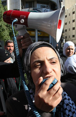 Protesters shout anti-Israel slogans during a demonstration in Damascus