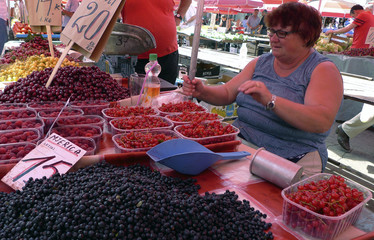 A vendor displays a wealth of spring fruits at her stand in Croatian capital Zagreb's main green market