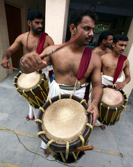 Traditionally dressed men play musical instruments during the festivities marking the end of the annual harvest festival in Chandigarh