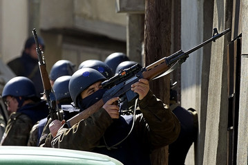 MACEDONIAN POLICEMAN AIMS HIS RIFLE DURING FIGHTING WITH ETHNIC ALBANIANS IN TETOVO.
