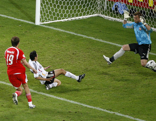 Poland's goalkeeper Boruc lets in goal by Germany's Neuville during their Group A World Cup 2006 soccer match in Dortmund