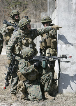 U.S. Marines equipped with Multiple Integrated Laser Engagement System (MILES) are pictured during a Force-on-Force military operation on urban terrain at the U.S. army's Rodriguez range in Pocheon
