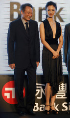 """Taiwan-born director Lee and actress Tang of China attend the premiere of Lee's new film """"Lust, Caution"""" in Taipei"""