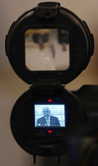 Palestinian President Abbas is seen in a video camera viewfinder as he speaks during a visit to an Argentine Islamic centre in Buenos Aires