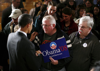 Democratic presidential candidate Senator Obama talks with a supporter during a campaign rally stop in Waterloo