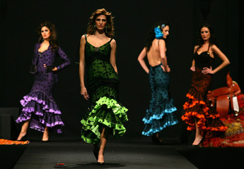 Models present creations from Loli Vera during the International Flamenco Fashion Show in Seville Fe..