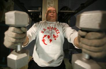 Iraq war veteran Ken Sargent works out in his garage at home at Camp Pendleton