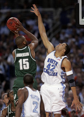 Michigan State forward Anderson shoots against North Carolina center May in first half of NCAA Final Four.