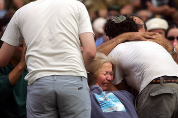 Lea Talesnikove, the mother of the Israeli soldier Dan Talesnikove mourns during his funeral at the ...