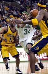 CELTICS DRIVES TO THE BASKET BY PACERS TINSLEY AND O'NEAL.