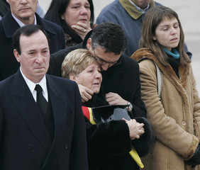 Parents of slain Spanish Civil Guard officer Trapero watch as his coffin passes by during his state funeral service in Valdemoro